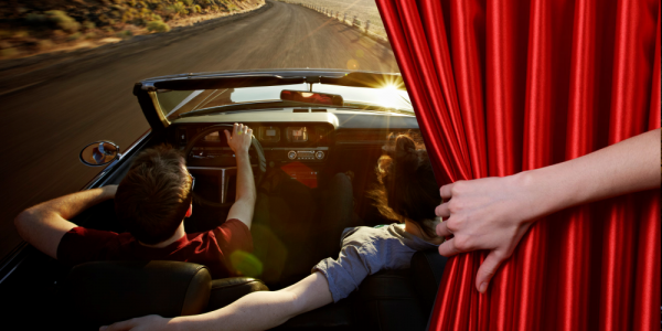 Image of a couple driving in a convertible on a scenic road for a blog on CA Driving and Traffic School Online Best Kept Secrets