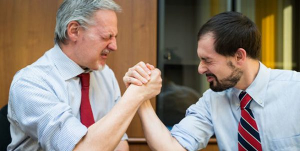 Image of two men arm wrestling for a blog on useful tips on how to fight a parking ticket in New York