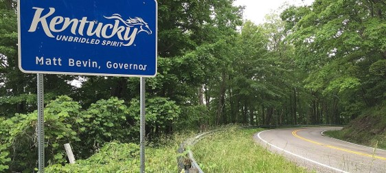Photograph of street sign of Kentucky for blog on tooks for Kentucky driving