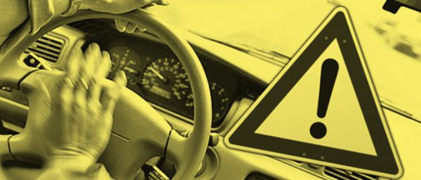 Image of someone honking car with a caution sign superimposed for blog on worst advice on CA driving