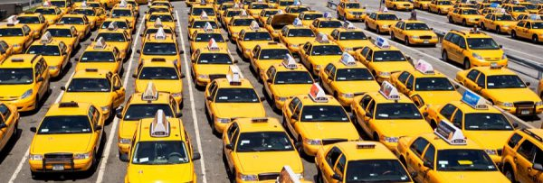 Photo of street full of New York yellow cabs for a blog on misconceptions about New York